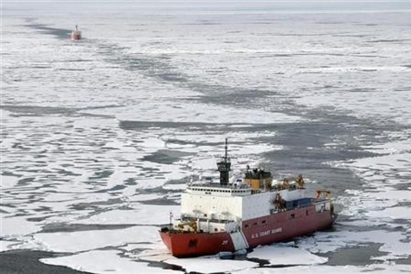 The Coast Guard Cutter Healy breaks ice ahead of the Canadian Coast Guard Ship Louis S. St-Laurent during an Arctic expedition, in this August 24, 2009 handout photo.