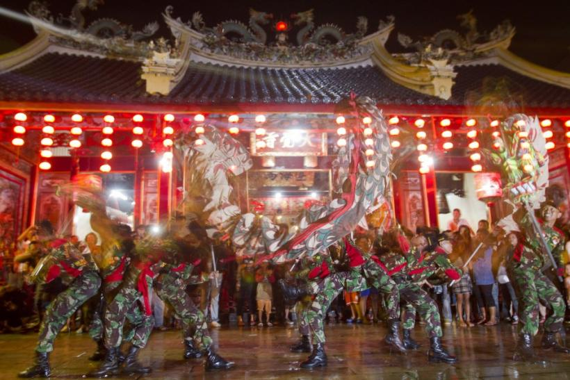 Soldiers perform dragon-dance in front of Tay Kei Sek temple in Semarang