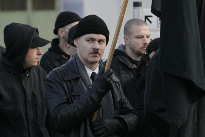 A neo-Nazi holds a black flag during an ultra right-wing rally in Remagen
