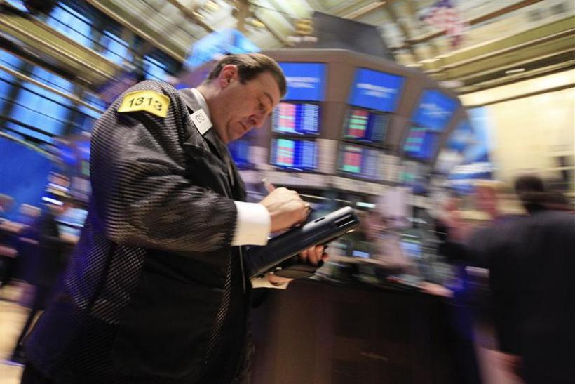 Traders work on the floor of the New York Stock Exchange January 20, 2012.