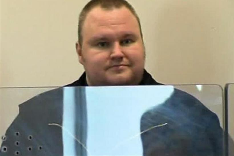 Still image from video shows Megaupload founder Kim Dotcom in Auckland's North Shore District Court after his arrest