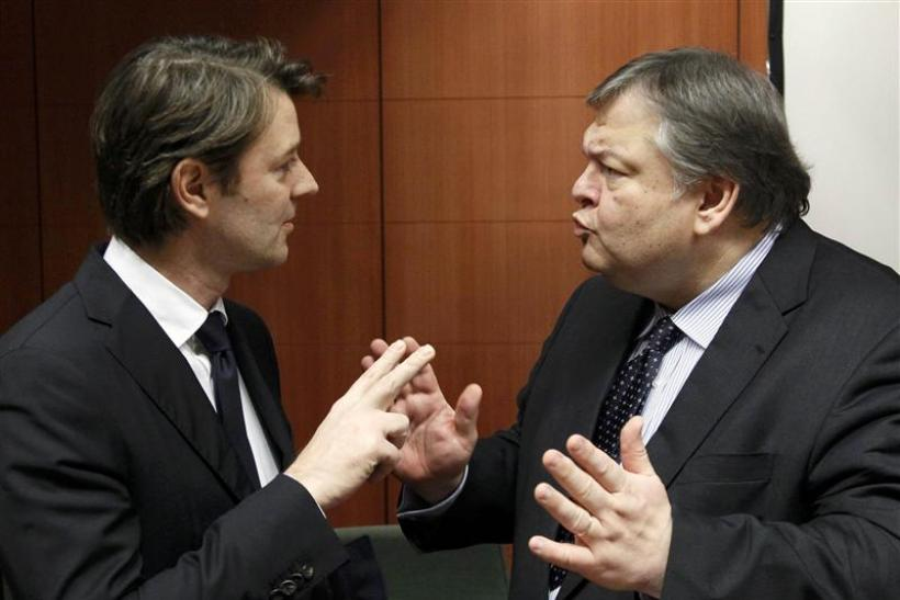 Francois Baroin talks with Evangelos Venizelos at a Eurogroup meeting at the European Union council headquarters in Brussels