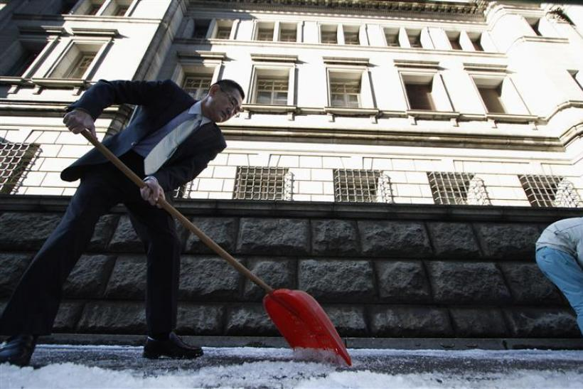 Staff of the Bank of Japan shovels the snow at the Bank of Japan in Tokyo