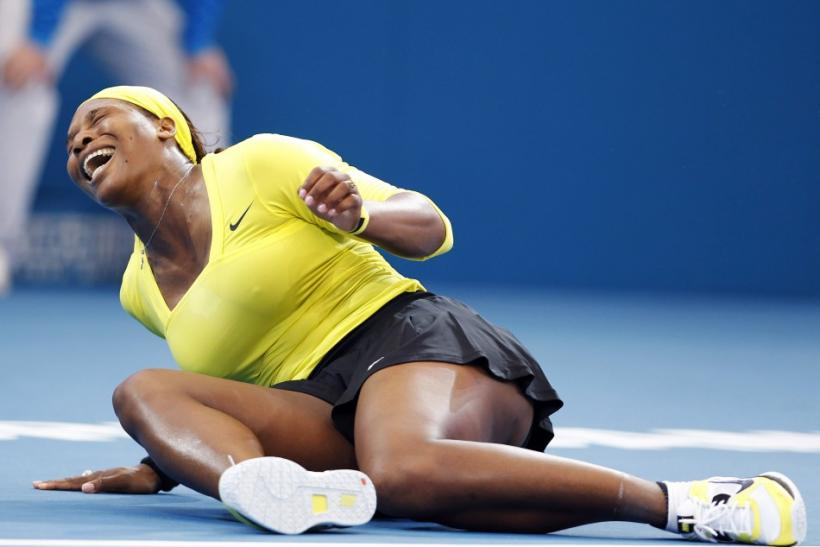 Serena Williams falls in pain on the ground