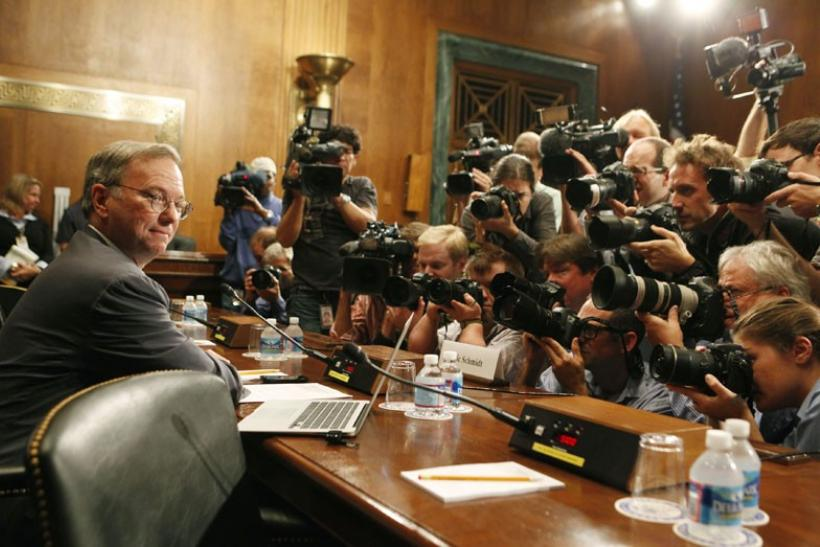 Executive Chairman of Google Eric Schmidt faces a wall of news photographers before a Senate Judiciary Subcommittee in Washington