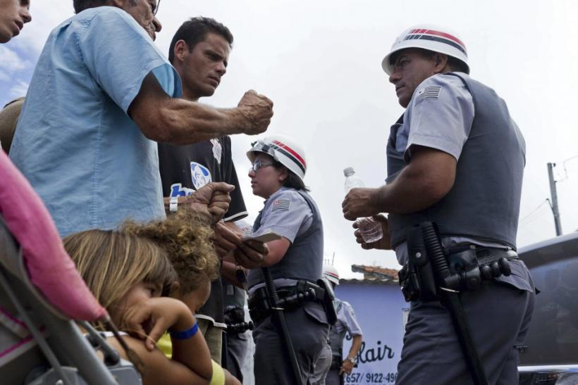 Residents of the Pinheirinho slum argue with police blocking access to their homes in Sao Jose dos Campos