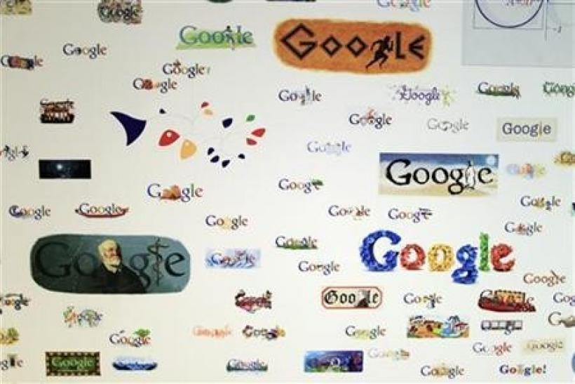 Google homepage logos are seen on a wall at the Google campus near Venice Beach, in Los Angeles, California January 13, 2012.