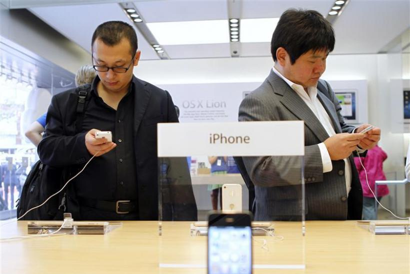 Customers try out the iPhone 4S at the Apple retail store in San Francisco