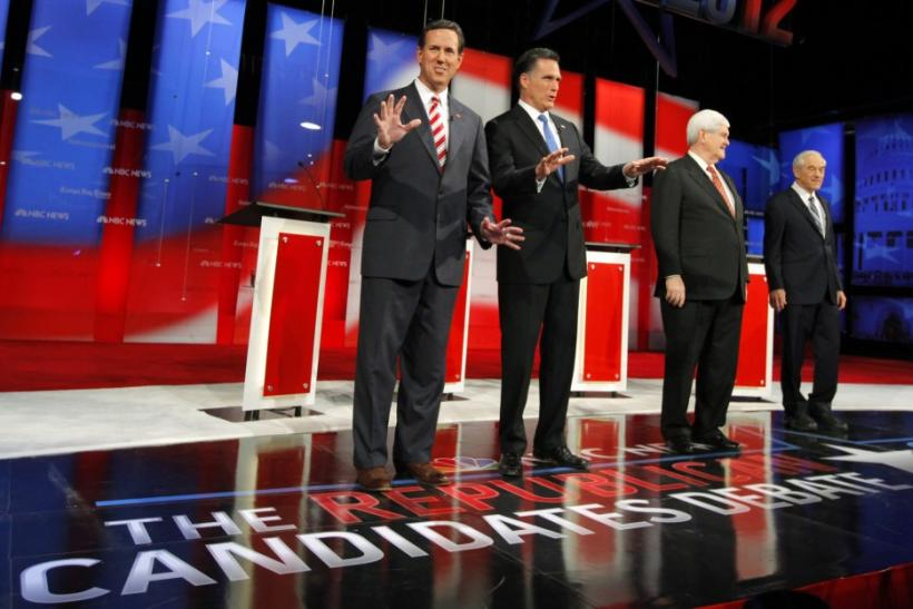 Republican presidential candidates arrive on stage before the Republican presidential candidates debate in Tampa