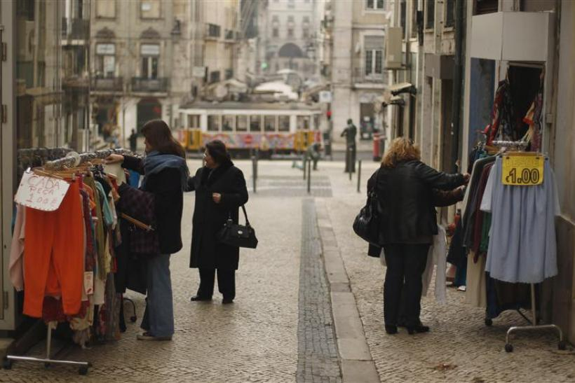 A shop sells garments for one euro in downtown Lisbon