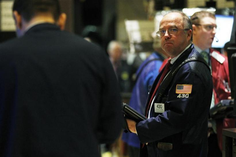 Trader Frederick Reimer works on the floor of the New York Stock Exchange