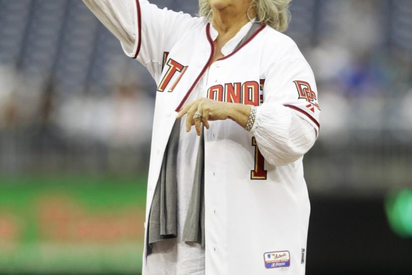 Food Network personality Paula Deen throws out the first pitch prior to the Washington Nationals versus New York Mets MLB baseball game in Washington