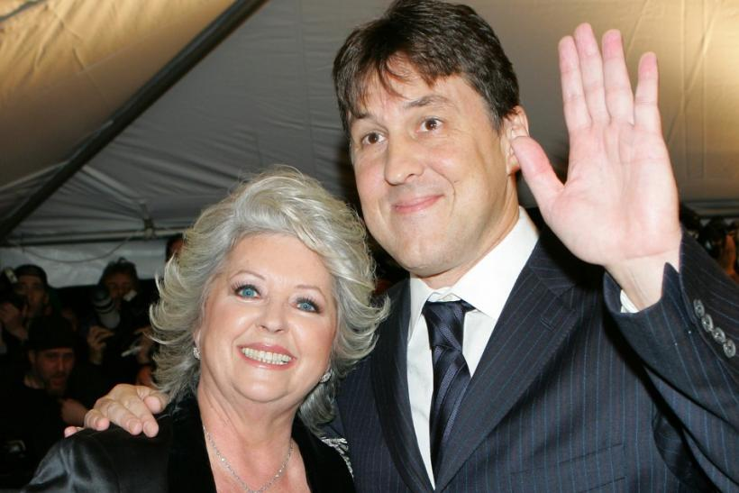 "Director Cameron Crowe and actress Paula Deen pose as they arrive for premiere of ""Elizabethtown"" in New York"