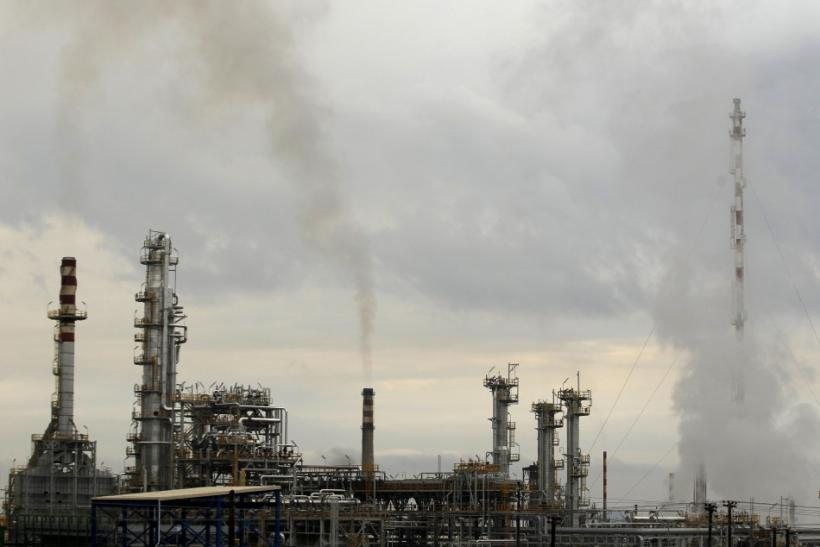 Smoke rises from the chimneys of an oil refinery near Corinth town, some 80km (50 miles) west of Athens January 24, 2012.