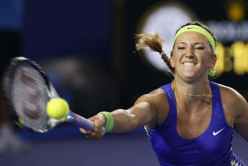 Victoria Azarenka of Belarus hits a return to Maria Sharapova of Russia during their women's singles final match at the Australian Open tennis tournament in Melbourne January 28, 2012.