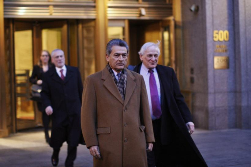 Former McKinsey chief and ex-Goldman Sachs director Rajat Gupta (C) exits the Manhattan Federal Court with his lawyers after attending a pre-trial hearing on insider-trading charges in New York January 5, 2012.