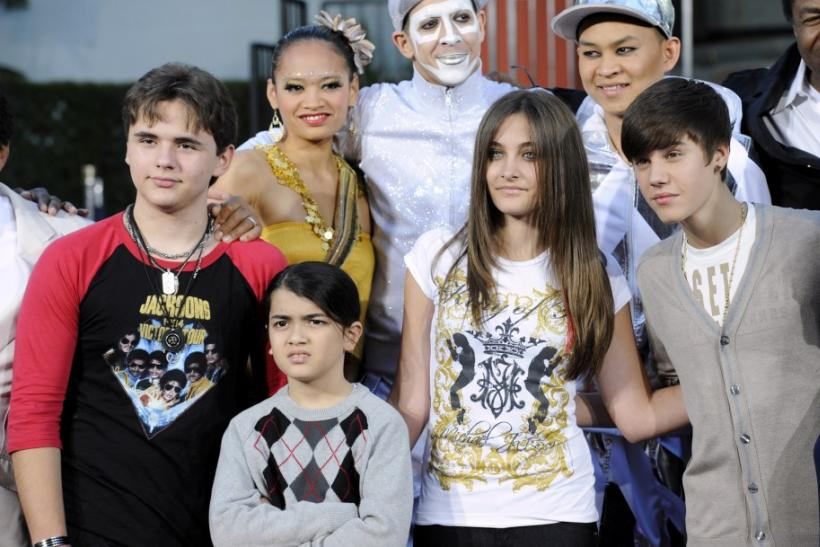Michael Jackson's children (L-R) Prince, Blanket, Paris and singer Justin Bieber pose for photographs at a ceremony where Jackson is immortalized with hand and foot imprints in cement in the courtyard of Hollywood's Grauman's Chinese Theatr