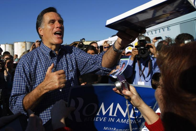 Republican presidential candidate and former Massachusetts Gov. Mitt Romney greets audience members at a campaign rally Florida