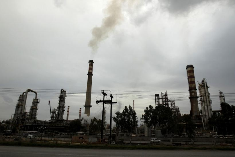 Smoke rises from the chimneys of an oil refinery on Jan. 24 near Corinth, about 50 miles west of Athens, Greece.