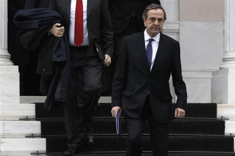 Conservative party leader Antonis Samaras leaves the Greek prime minister's office after a meeting in Athens