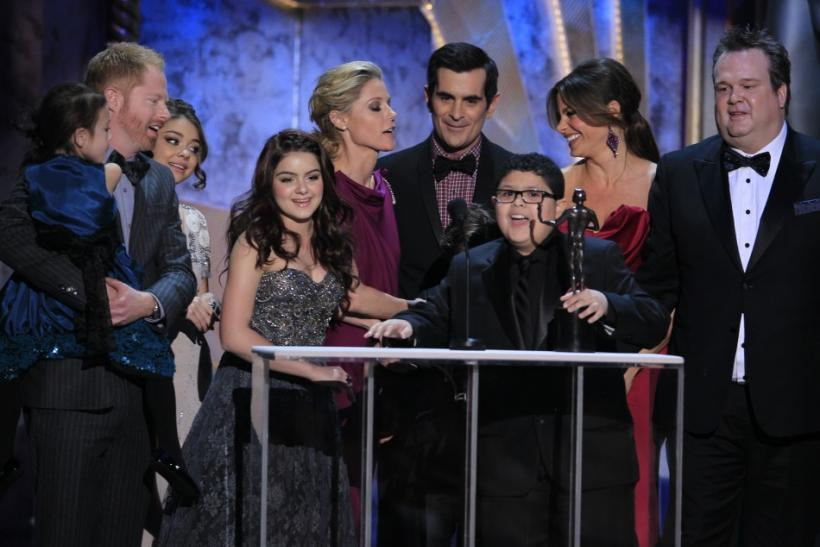 "The cast of ""Modern Family"" accepts the award for outstanding performance by an ensemble in a comedy series at the 18th annual Screen Actors Guild Awards in Los Angeles, California January 29, 2012."