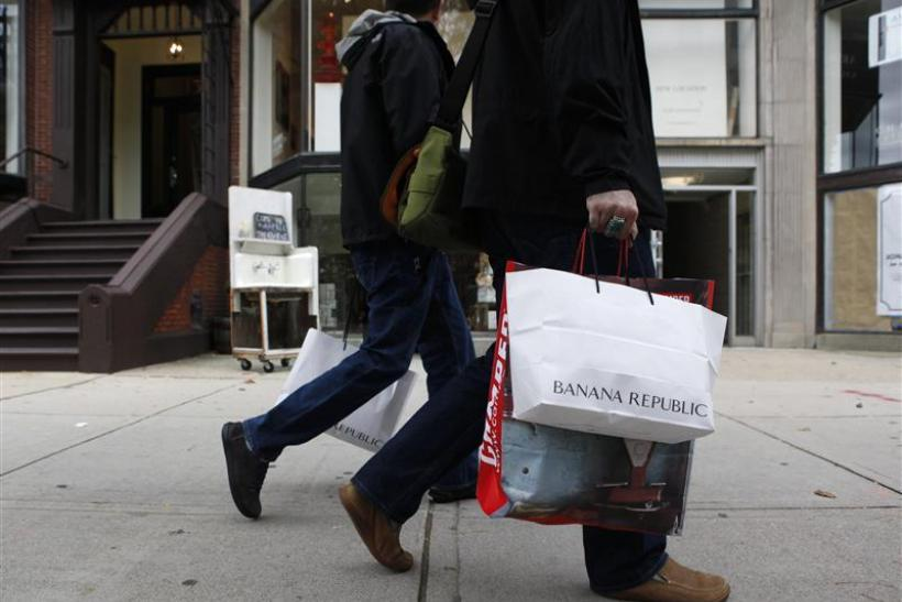 People walk along Newbury Street carrying shopping bags in Boston