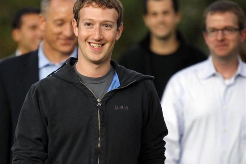 Mark Zuckerberg walks out to speak to reporters at Harvard University in Cambridge