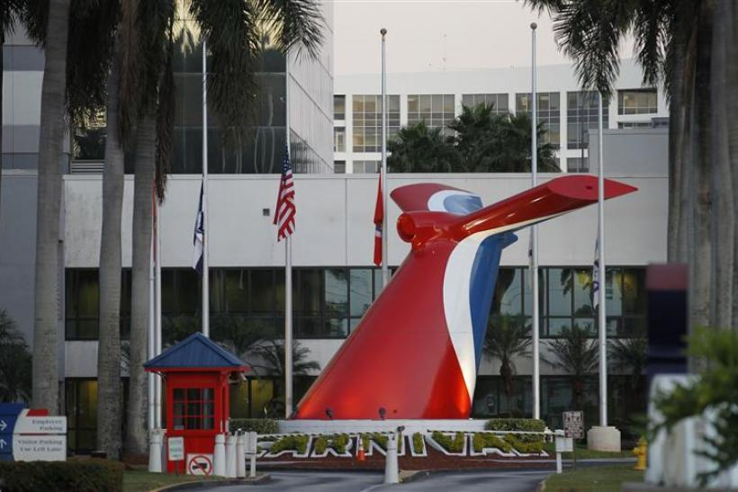 Flags are shown at half-mast outside the headquarters of Carnival Cruise Lines in Doral