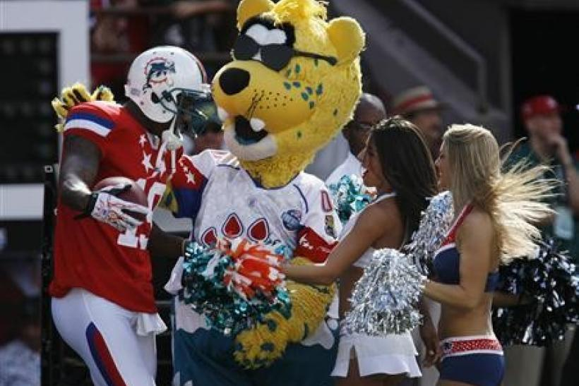 AFC wide receiver Brandon Marshall of the Miami Dolphins (L) celebrates with an NFL mascot and cheerleaders after scoring a touchdown during the second quarter of the NFL Pro Bowl at Aloha Stadium in Honolulu, Hawaii