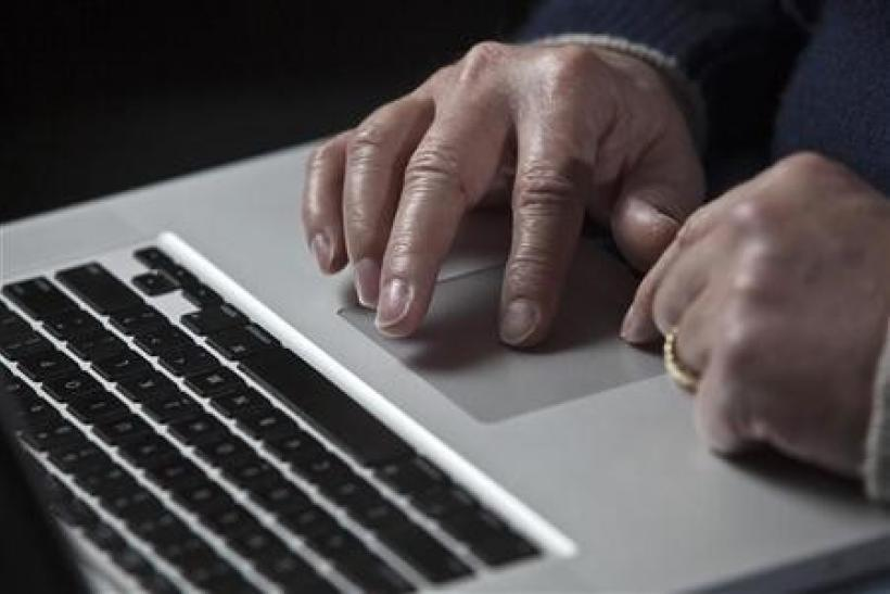 John Bumgarner, a cyber warfare expert who is chief technology officer of the U.S. Cyber Consequences Unit, a non-profit group that studies the impact of cyber threats, works on his laptop computer during a portrait session in Charlotte, North Carolina De