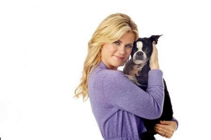 Television personality Alison Sweeney poses with her Boston Terrier ''Winky'' in this publicity photo released to Reuters