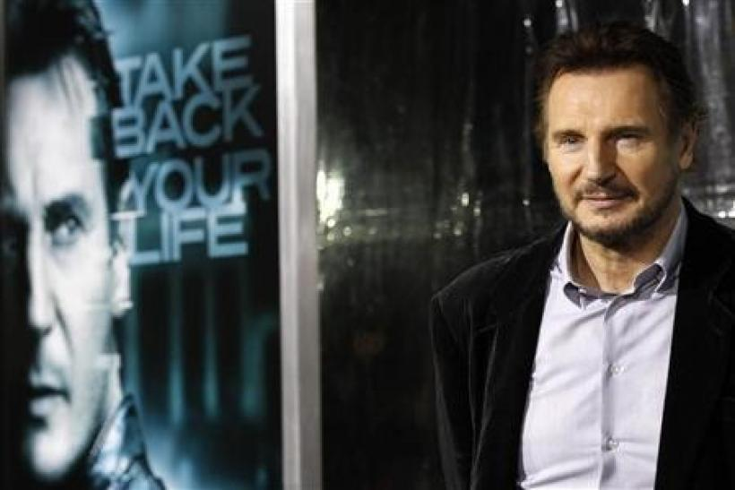Cast member Liam Neeson poses at the premiere of ''Unknown'' at the Mann Village theatre in Los Angeles