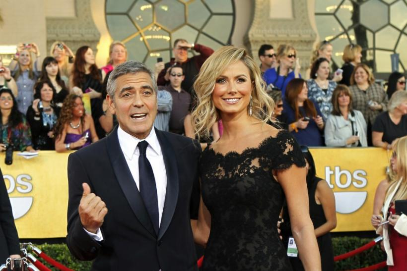 "Actor George Clooney from the movie ""The Descendants"" and actress Stacy Keibler pose on arrival at the 18th annual Screen Actors Guild Awards in Los Angeles, California"