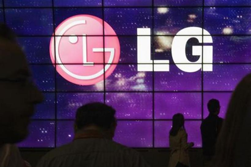 Showgoers walk past a display at the LG Electronics booth during the 2012 International Consumer Electronics Show (CES) in Las Vegas
