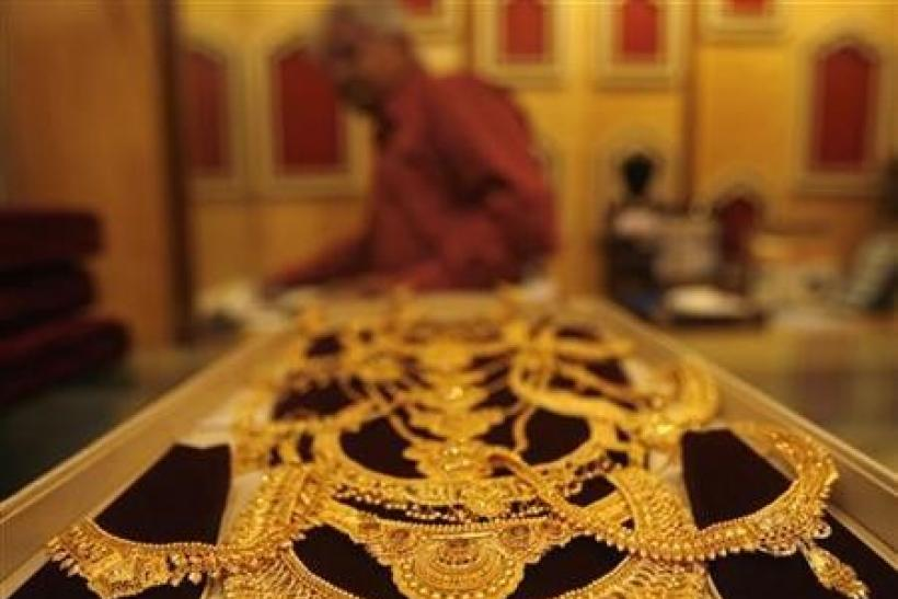 India increases base import price of gold, silver