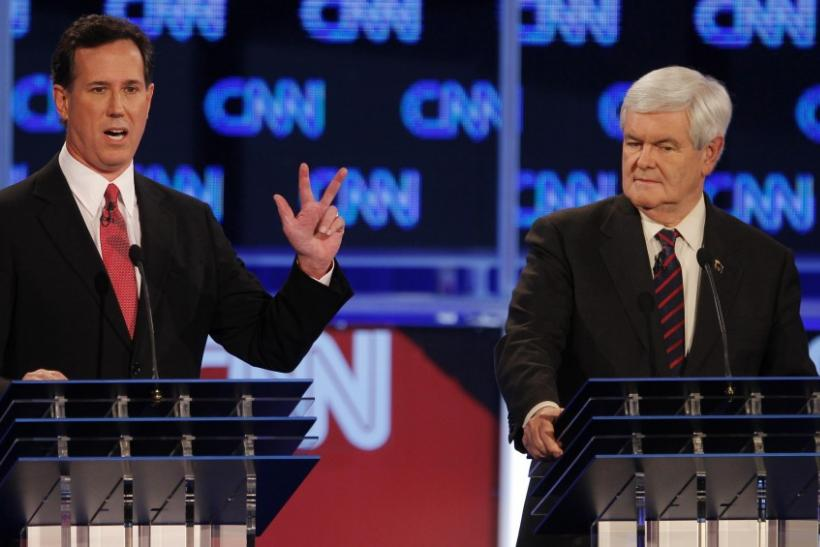 Republican presidential candidate Santorum speaks as Gingrich listens during the Republican presidential candidates debate in Jacksonville