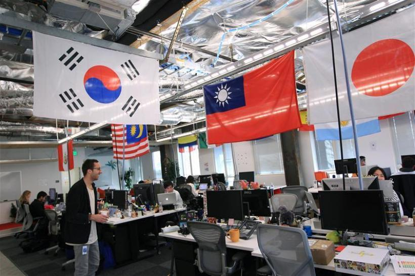 Employees work in the international user operations area at the new headquarters of Facebook in Menlo Park