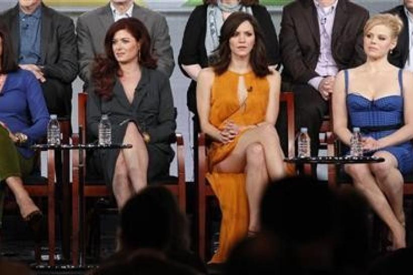 (L - R) Cast members Anjelica Huston, Debra Messing, Katharine McPhee and Megan Hilty attend the panel for the NBC television series ''Smash'' at the Television Critics Association winter press tour in Pasadena, California