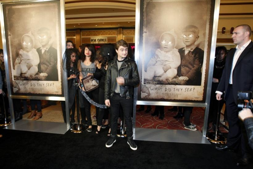 "Cast member Daniel Radcliffe poses at a special screening of ""The Woman in Black"" in Los Angeles, California"