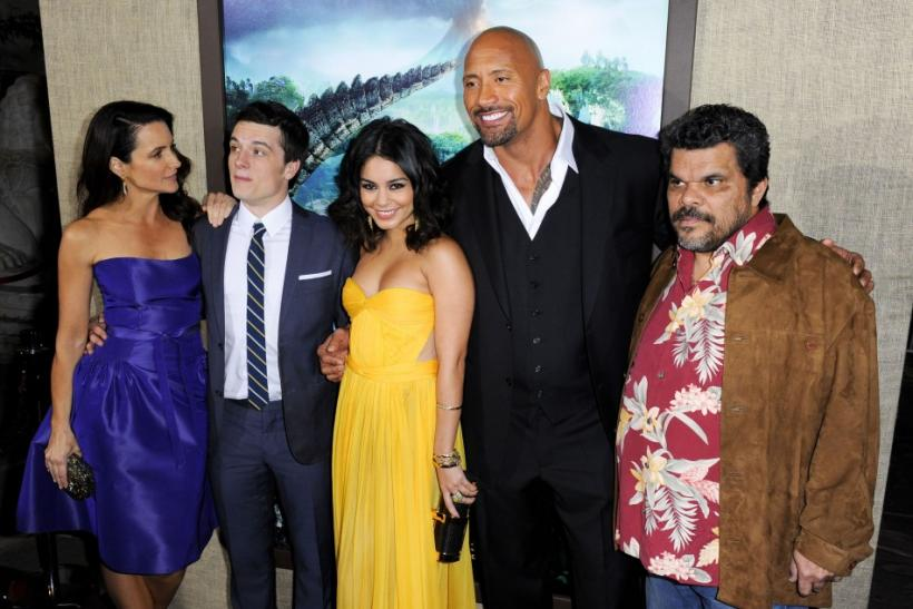 "(L-R) The cast from ""Journey 2: The Mysterious Island"" actors Kristin Davis, Josh Hutcherson, Vanessa Hudgens, Dwayne Johnson and Luis Guzman pose for photographers during the premiere in Los Angeles, California"