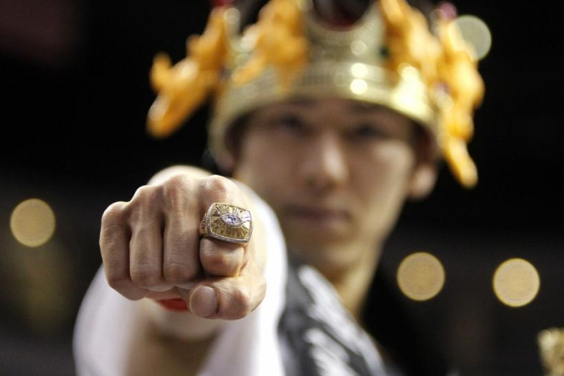 "Competitive eater Takeru Kobayashi of Japan shows the prize ring after winning ""Wingbowl 20"", the annual chicken wing eating contest in Philadelphia, Pennsylvania"