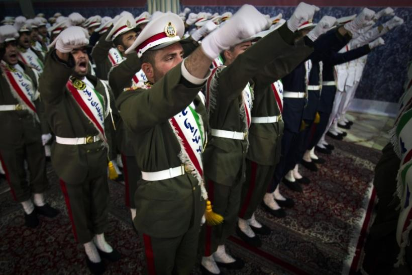 Iranian soldiers shout anti-U.S. slogans during the anniversary ceremony of Iran's Islamic Revolution at the Khomeini shrine in the Behesht Zahra cemetery, south of Tehran, February 1, 2012.