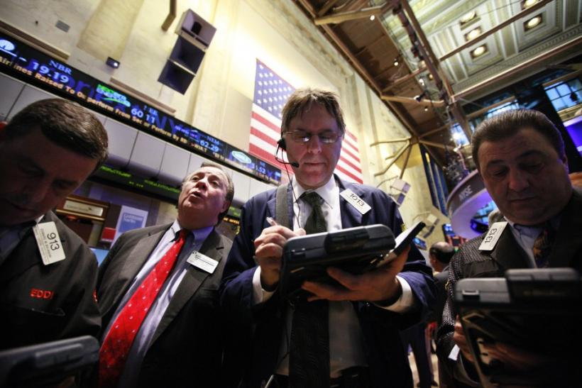 Traders gather at a post on the floor of the New York Stock Exchange February 3, 2012.