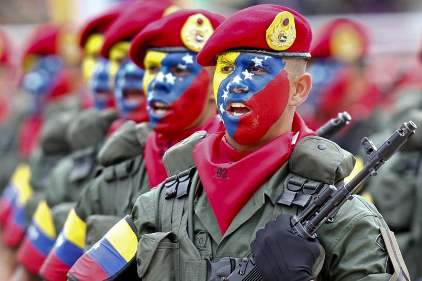 Venezuelan soldiers march during a military parade to commemorate the 20th anniversary President Hugo Chavez's failed coup attempt in Caracas February 4, 2012.