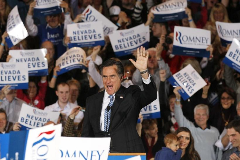 Republican U.S. presidential candidate and former Massachusetts Governor Mitt Romney waves to his supporters while speaking at his Nevada caucus night rally in Las Vegas, Nevada, FebruaRepublican U.S. presidential candidate and former Massachusetts Govern