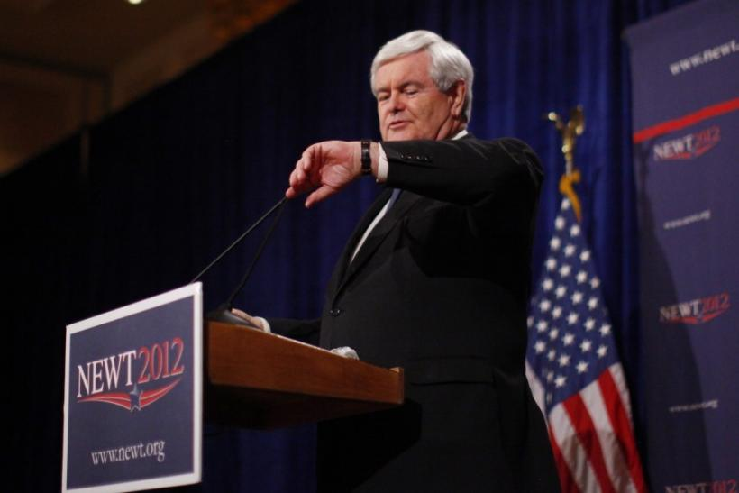 Republican U.S. presidential candidate Newt Gingrich looks at his watch as he speaks at a news conference on Saturday in Las Vegas after the Nevada caucuses in Las Vegas, Nevada, February 4, 2012.
