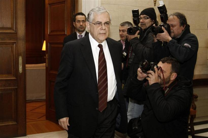 Prime Minister Lucas Papademos arrives at his office in Athens for a meeting with top Greek political leaders