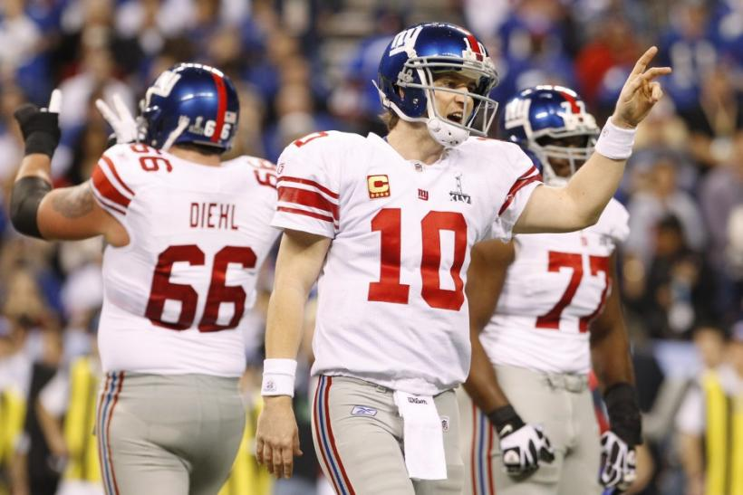New York Giants quarterback Eli Manning gestures after throwing for first down in the first quarter in the NFL Super Bowl XLVI football game against the New England Patriots in Indianapolis, Indiana