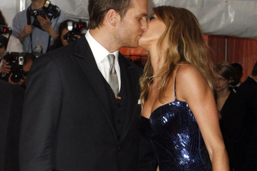 "New England Patriots quarterback Tom Brady kisses his wife model Gisele Bundchen at the Metropolitan Museum of Art Costume Institute Gala ""The Model As Muse: Embodying Fashion"" in New York"