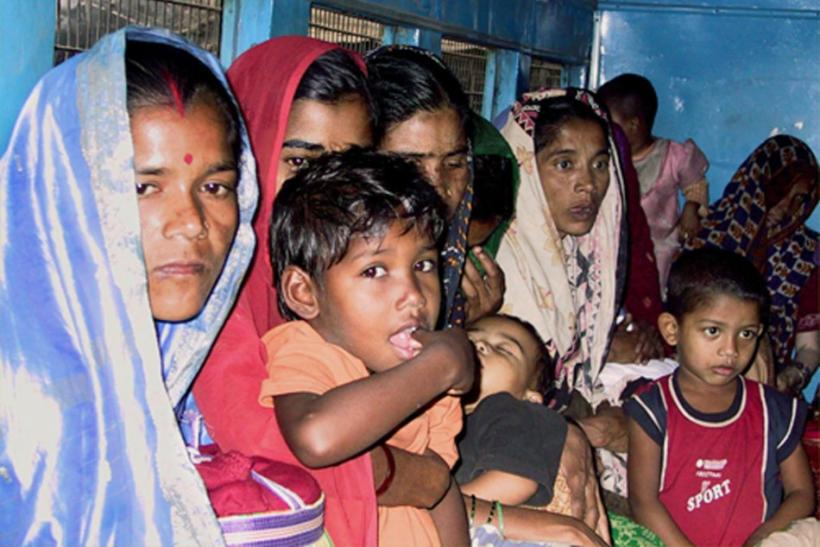 Bangladeshi women and children sit inside a crowded police van before appearing in court in Howrah, some 20 km (12 miles) west of the eastern Indian city of Calcutta